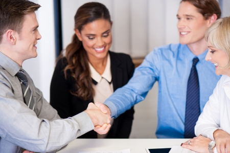 formals: Businessmen shake hands to seal the deal Stock Photo