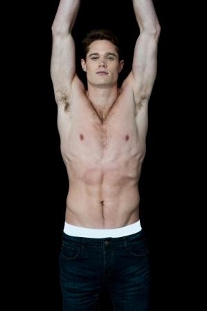 armpits: Fit man exposing his muscular body Stock Photo