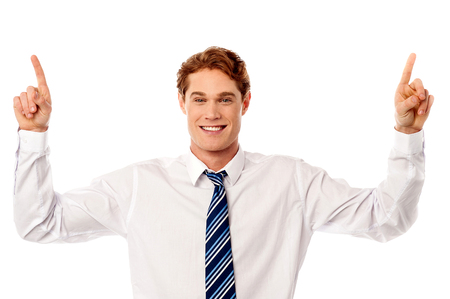 Young businessman pointing upwards photo