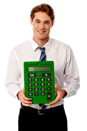 Young business executive with big green calculator photo