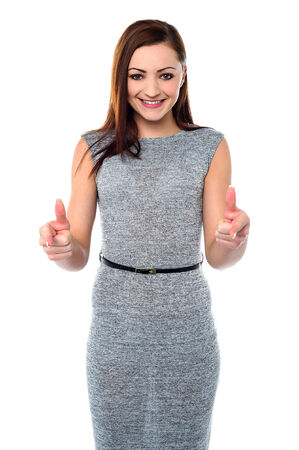 yup: Smiling woman showing double thumbs up Stock Photo