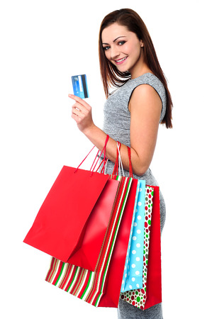 Young woman holding shopping bags and credit card photo