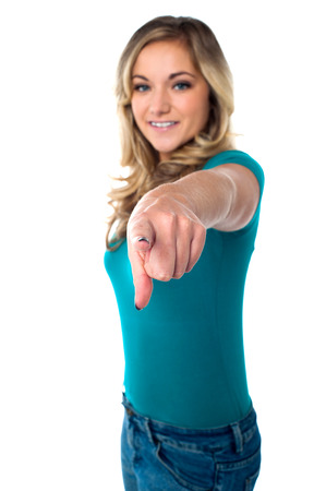 Attractive female pointing towards you photo
