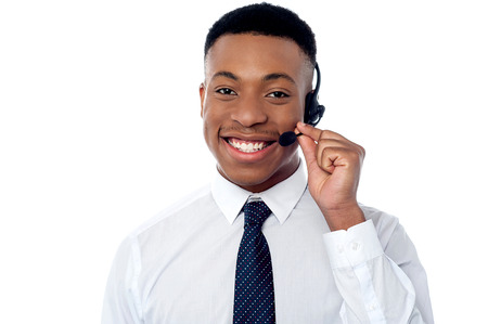 customer care: Smiling young call center executive