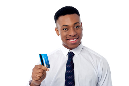 debit card: Young corporate guy showing his debit card