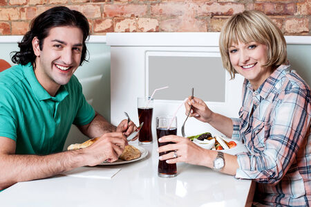 Young couple having dinner at a restaurant photo