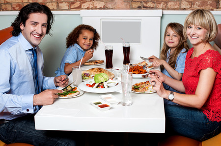Family enjoying dinner outdoors on weekend photo