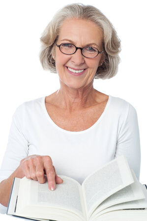 woman reading book: Image of aged woman with an open book