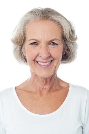 笑みを浮かべて白い背景で隔離の女性高齢者 写真素材