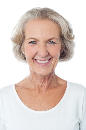 Smiling aged woman isolated over white background