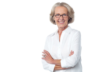 Confident beautiful aged woman against white photo