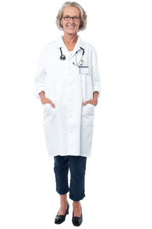 Aged medical professional with stethoscope photo