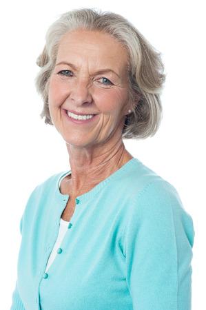 Studio shot of a pretty smiling senior woman