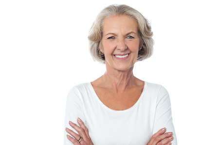 Aged woman with crossed arms isolated over white photo