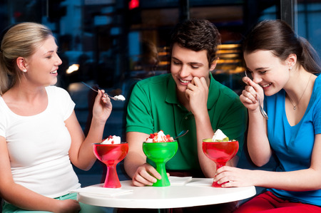 relishing: Three friends enjoying day out in a restaurant. Stock Photo