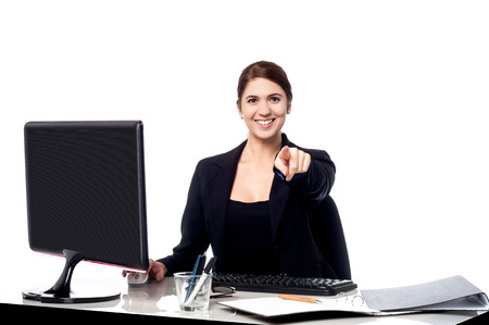 Businesswoman pointing a finger in office, looking camera photo