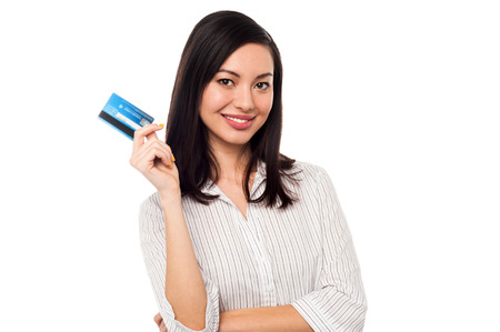 Attractive female executive displaying her credit card