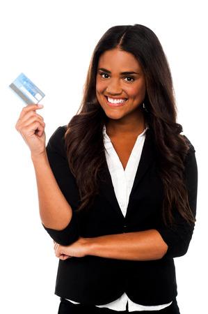 debit card: Beautiful young business executive showing debit card Stock Photo