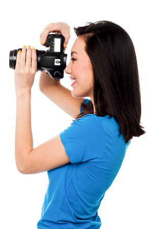 say cheese: Professional female fashion photographer taking a snapshot