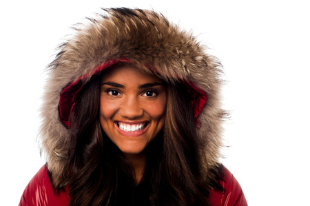 Smiling girl wearing furry hood winter jacket photo