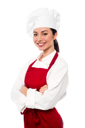 Pretty baker woman posing with confidence, arms folded. photo