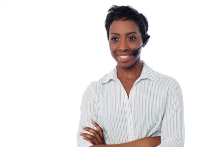 Young female call centre executive posing with confidence photo
