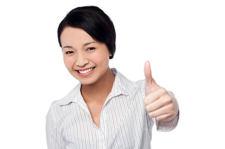 Pretty young girl showing thumbs up gesture