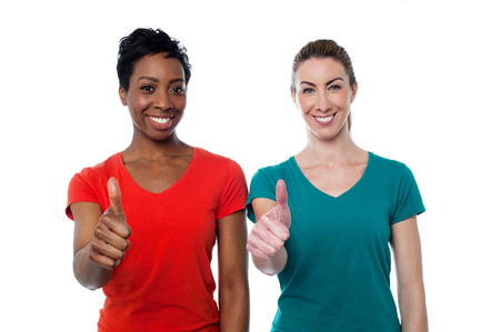 Smiling casual women showing thumbs up photo