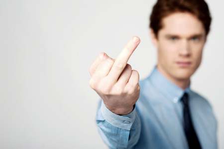 unkind: Business man making a rude hand gesture Stock Photo
