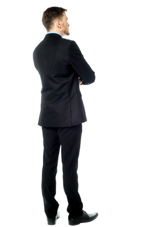Rear view image of young male business executive photo