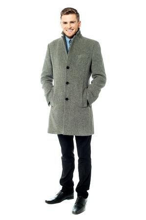 overcoat: Young businessman wearing trendy overcoat