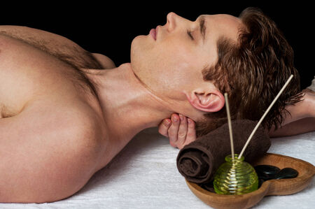 Man relaxing getting neck back massage photo