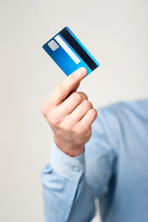 swap: Cropped image of businessman displaying his credit card