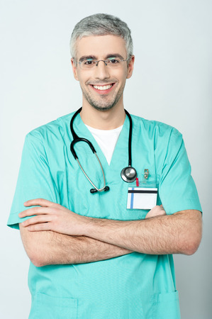 eye care professional: Smiling senior doctor with stethoscope