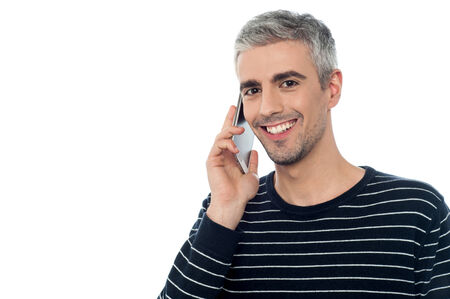 Smart middle aged man talking on mobile phone photo