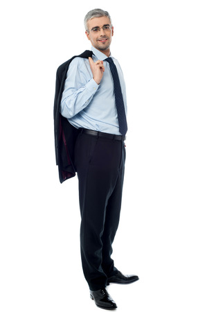 Happy aged businessman with coat on shoulder photo