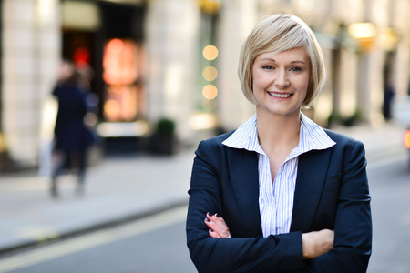 aged business: Confident corporate lady posing outdoors