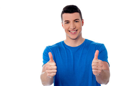 Successful young man showing double thumbs up