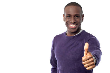 Smiling young man with showing thumbs up Stock Photo