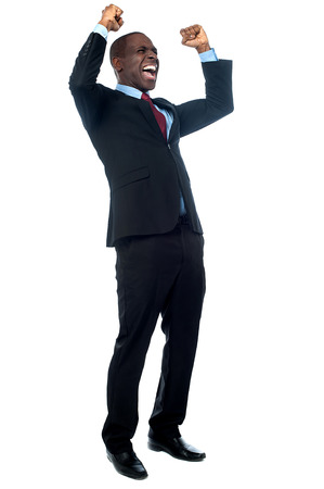 Excited entrepreneur clenching his fists Stock Photo