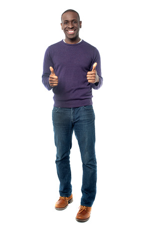 Smart young man showing double thumbs up