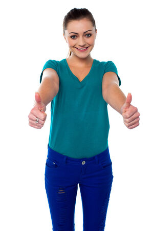 Smiling woman showing double thumbs up Stock Photo