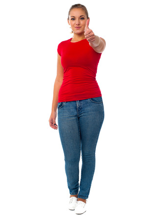 Teen girl showing thumbs up to camera Stock Photo