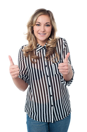 posing  agree: Attractive woman showing double thumbs up