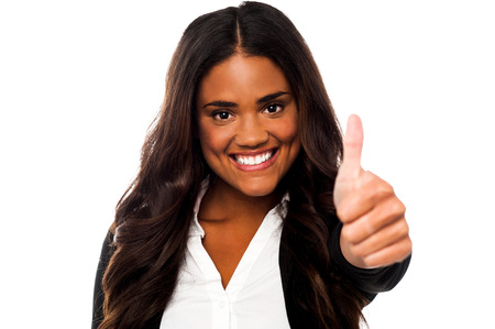 yup: Smiling woman showing thumbs up
