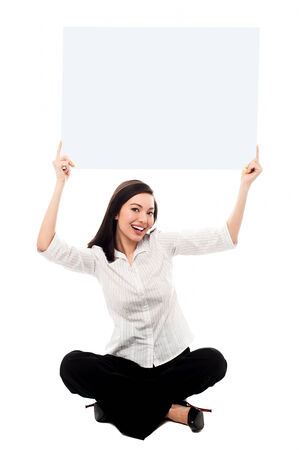 Young woman holding ad board above her head photo
