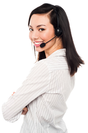 Cheerful female call center executive wearing headset photo