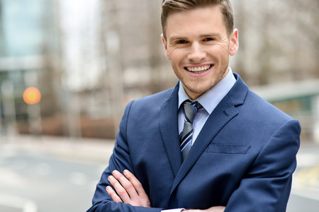 Handsome corporate guy posing confidently at outdoors photo