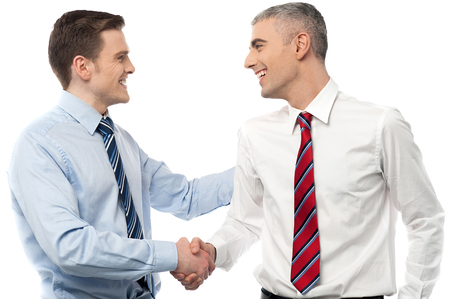 Business people shaking hands over a deal photo