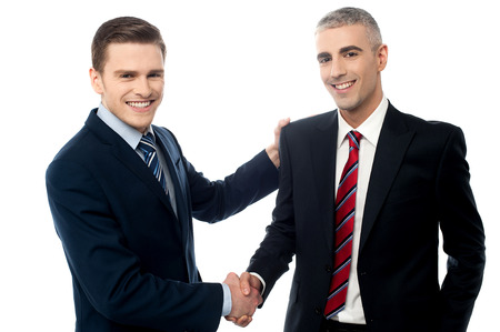 Business handshake of two successful partners photo